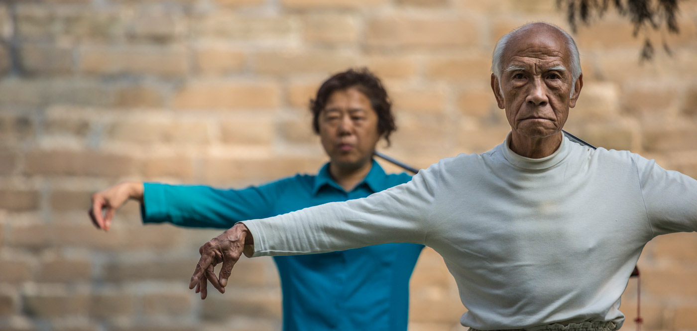 Couple Performing Sword Tai Chi