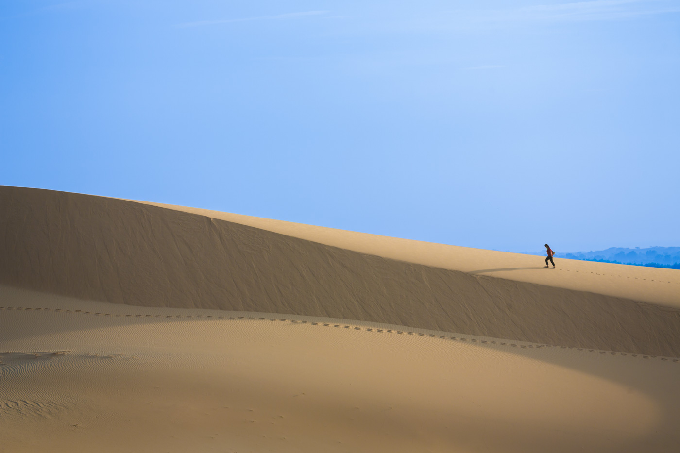 Hiker on Dunes. Mui Ne, Vietnam