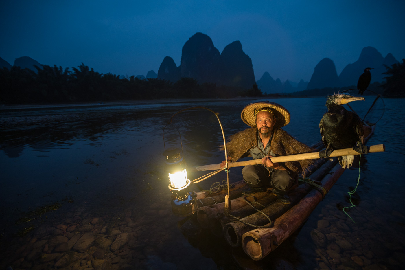 Six other photographers shot from a distance on shore instead of getting wet - Yangshuo Fisherman